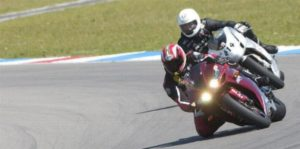 Coach Can is working with a track rider 1on1 at TT Circuit Assen in the Netherlands